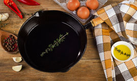 Ingredients for a breakfast and iron skillet. Royalty Free Stock Image