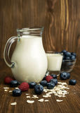 Ingredients for breakfast : milk, cereal , blueberries and raspberries Stock Photo