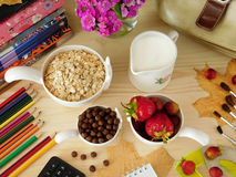 Ingredients for breakfast surrounded by school supplies Royalty Free Stock Image