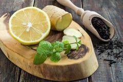 Ingredients for brewing tea: black tea, ginger, lemon, mint Stock Photo