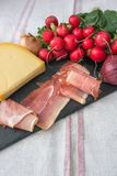 Ingredients for  brunch, ham, cheese and vegetables. Ingredients for rustic brunch, ham, cheese and vegetables Stock Image