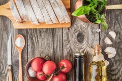 Ingredients for  bruschetta on the wooden table horizontal Royalty Free Stock Photography
