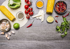 Ingredients for burritos with tomato, pepper, spicy chili, corn, cheese and garlic border space for text on grey wooden rusti Stock Photos