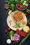 Ingredients for burritos wraps with beef and vegetables on black background. Mexican food. Top view. Flat lay Royalty Free Stock Photo