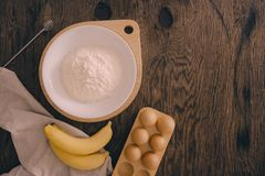 Ingredients for butter cake on wooden table royalty free stock photo