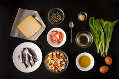 Ingredients for Caesar salad on the black background horizontal Royalty Free Stock Photos