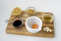 Ingredients: Caesar Salad with chicken. Wooden board with ingredients for preparation of Caesar salad with chicken Stock Photos