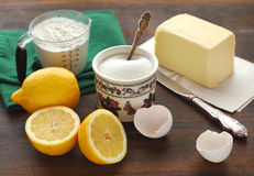 Ingredients for cake. Flour, sugar, eggs, butter and lemons Stock Photos