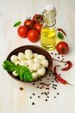 Ingredients for Caprese : mozzarella , cherry tomatoes and basil Stock Photos