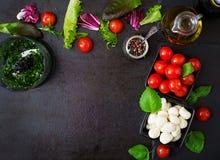Ingredients Caprese salad tomato and mozzarella Stock Image