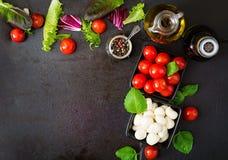 Ingredients Caprese salad tomato and mozzarella Stock Photo