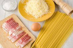 Ingredients of the carbonara paste on a light background. royalty free stock photography