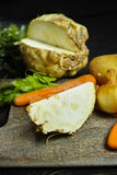 Ingredients for celeriac soup - celery root - celeriac, carrots, Stock Photo