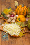 Ingredients for cheese fondue on autumn leaves Royalty Free Stock Photography