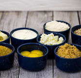 Ingredients for cheesecake , in a bowl. Ingredients for cheese cakes, blue round shapes Stock Photo