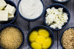 Ingredients for cheesecake , in a bowl. Ingredients for cheese cakes, blue round shapes Stock Image
