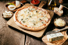 Ingredients for a 4 cheeses Italian pizza Royalty Free Stock Photography