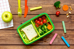 Ingredients for children`s lunch on wooden background top view royalty free stock images