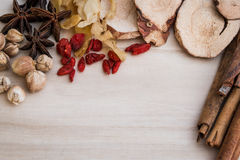 Ingredients for Chinese herbal soup on wooden background Royalty Free Stock Images