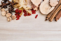 Ingredients for Chinese herbal soup on wooden background Royalty Free Stock Photo