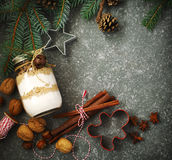 Ingredients for Christmas baking and tree branches with pine cones and holiday decoration Royalty Free Stock Photography