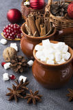 Ingredients for the Christmas holiday baking, beverages or gifts marshmallow, cinnamon sticks, anise stars, in baskets Stock Photo