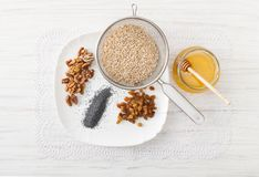 Ingredients for Christmas porridge laced napkin. Recipes for Christmas dishes. Ingredients on a white table to corner wheat, nuts, raisins, poppy seeds, honey Royalty Free Stock Images