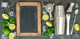 Ingredients for cocktail drink. Lime and mint leaves. Chalkboard for Your recipe text Royalty Free Stock Photo