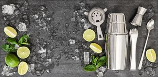 Ingredients cocktail lime mint ice black background. Ingredients for cocktail lime, mint, ice on black background royalty free stock photo