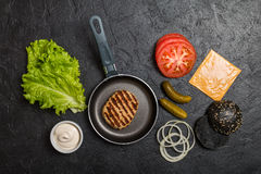 Ingredients for cooking black burger. Royalty Free Stock Images