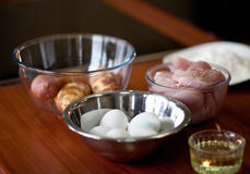 Ingredients for cooking. Boiled potato, chicken breasts, eggs and oil Stock Photography