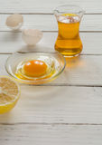 ingredients for cooking. Broken egg shells and oil. Stock Photo