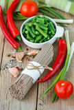 Ingredients for cooking buckwheat noodles with vegetables - dry raw buckwheat noodles, red peppers, green beans, garlic, tomatoes Royalty Free Stock Photo