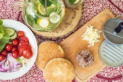 Ingredients for cooking burgers. Raw ground beef Royalty Free Stock Images