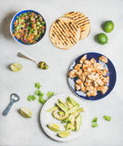 Ingredients for cooking chicken and avocado tacos, grey marble background Stock Image