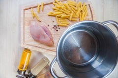 Ingredients cooking chicken fillet pasta wooden background top view. Ingredients for cooking chicken fillet pasta with spices on wooden background top view close Royalty Free Stock Photography