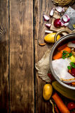 Ingredients for cooking chicken soup with vegetables and spices. On a wooden table Stock Images