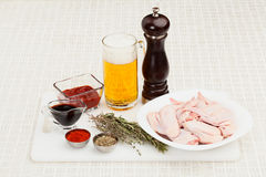 Ingredients for cooking chicken wings. In sauce to beer on a cutting board closeup Stock Photo