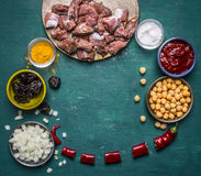 Ingredients cooking Chopped into pieces of lamb a cutting board  chickpeas tomato sauce prunes chopped onion spices Royalty Free Stock Photos