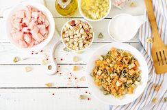 Ingredients for cooking creamy pasta with chicken and eggplant served in deep plate. Royalty Free Stock Image
