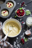 Ingredients for cooking cupcakes with red currants Stock Image