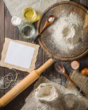 Ingredients for cooking dough or bread. Bunch of white rye flour. Dark wooden background. Stock Images