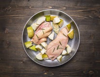 Ingredients for cooking duck breast with fruit, herbs and honey  in a frying pan wooden rustic background top view close up Royalty Free Stock Photo