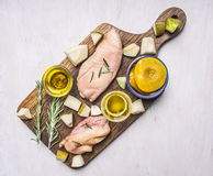 Ingredients for cooking duck breast with fruit, herbs and honey wooden rustic cutting board top view close up Stock Photo