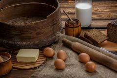 Ingredients for cooking, eggs, honey, bread, flour and milk Royalty Free Stock Images