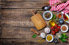 Ingredients for cooking and empty cutting board on Royalty Free Stock Photography