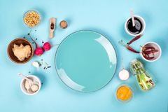 The most famous Korean traditional food Kimchi ingredients. Ingredients for cooking a famous Korean dish kimchi from radish with a blue plate in the middle with Royalty Free Stock Image