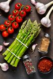 Ingredients for cooking. Fresh vegetables: asparagus, tomatoes. Garlic and spices. Organic food Stock Image