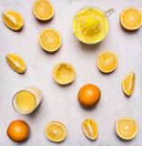 Ingredients for cooking freshly squeezed orange juice fresh oranges and manual juicer wooden rustic background top view close u Royalty Free Stock Photography