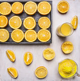 Ingredients for cooking freshly squeezed orange juice fresh oranges and manual juicer wooden rustic background top view close u Stock Photo
